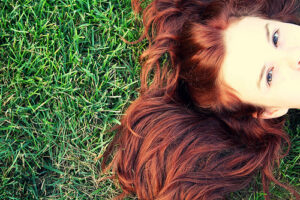 red hair and green grass