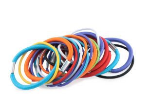 A large stack of colourful ponytail holders