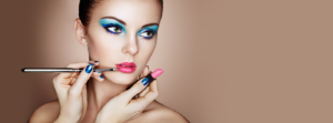 Woman with blue eye makeup and pink lipstick