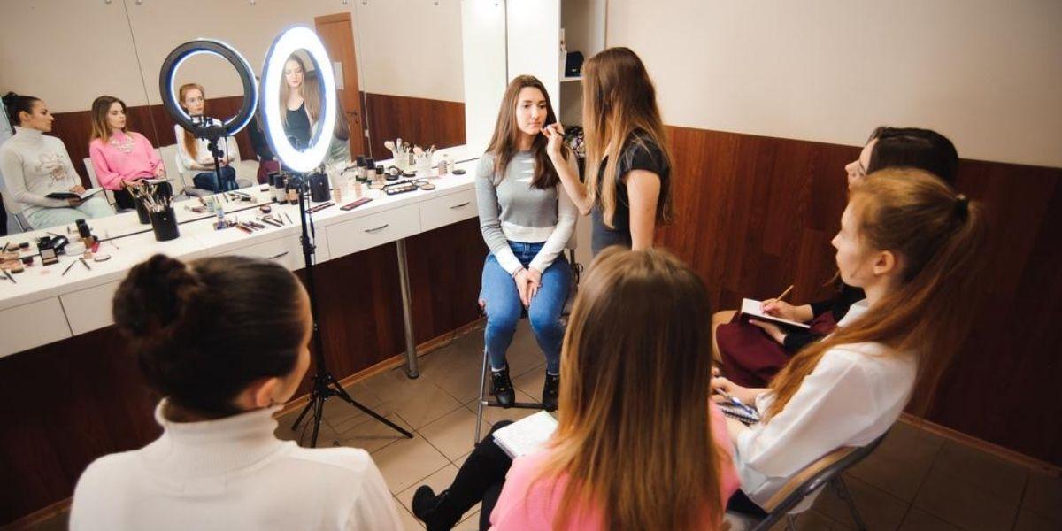 woman teaching a class how to do makeup