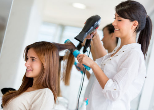 self employed hair stylist working in salon