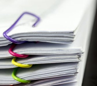 stack of tax forms for hair stylists