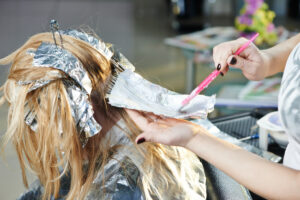 Girl with hair foils in her hair