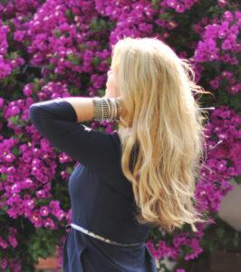 Blonde hair; purple flowers