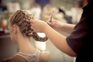 Woman having her hair intricately braided
