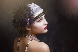 Female model with red lipstick, jewelry and a floral headband