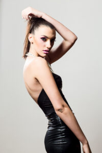 Female model in tight black dress