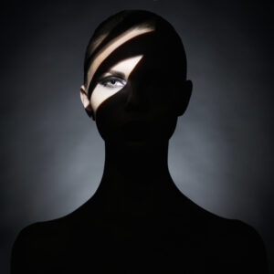 woman with shadow on her face