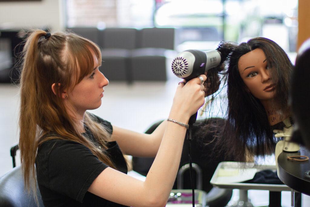 Avalon Institute student blowdrying hair