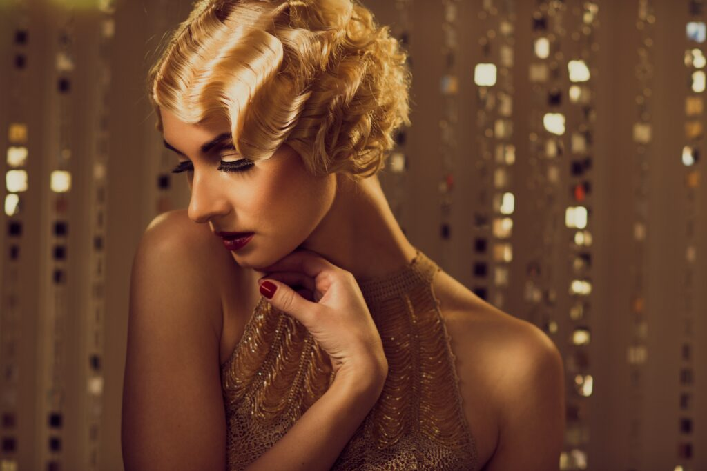 blonde woman in gold dress with vintage wavy hairstyle