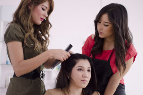 beauty school instructor teaching a student