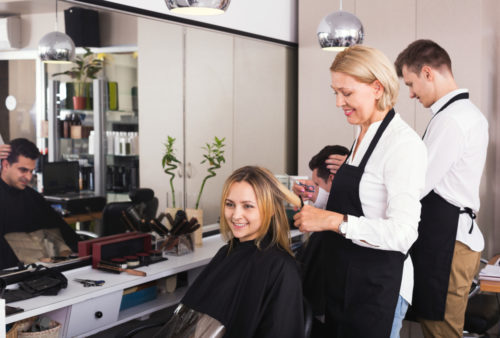 student and instructor working in salon