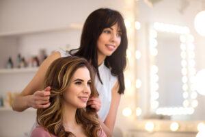 Hair dresser doing woman's hair