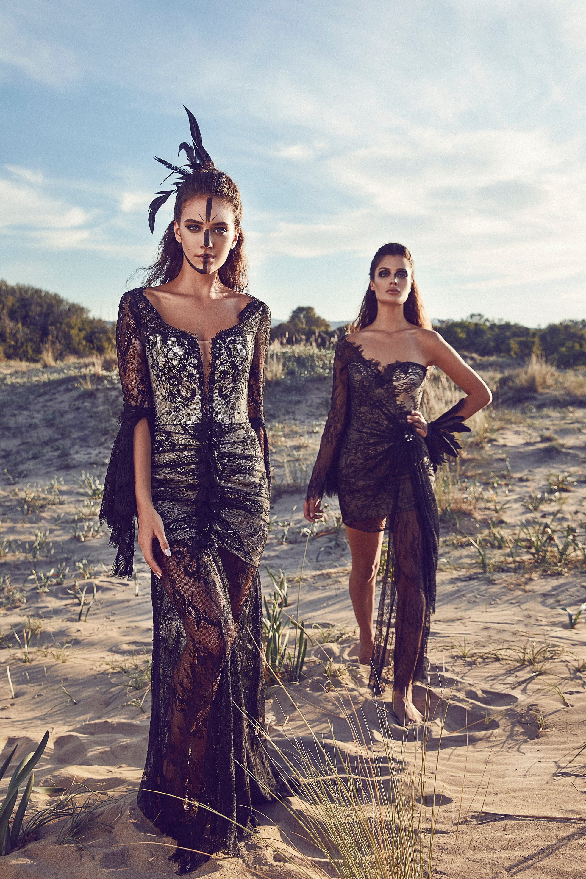 Two women modeling dresses and makeup in the desert