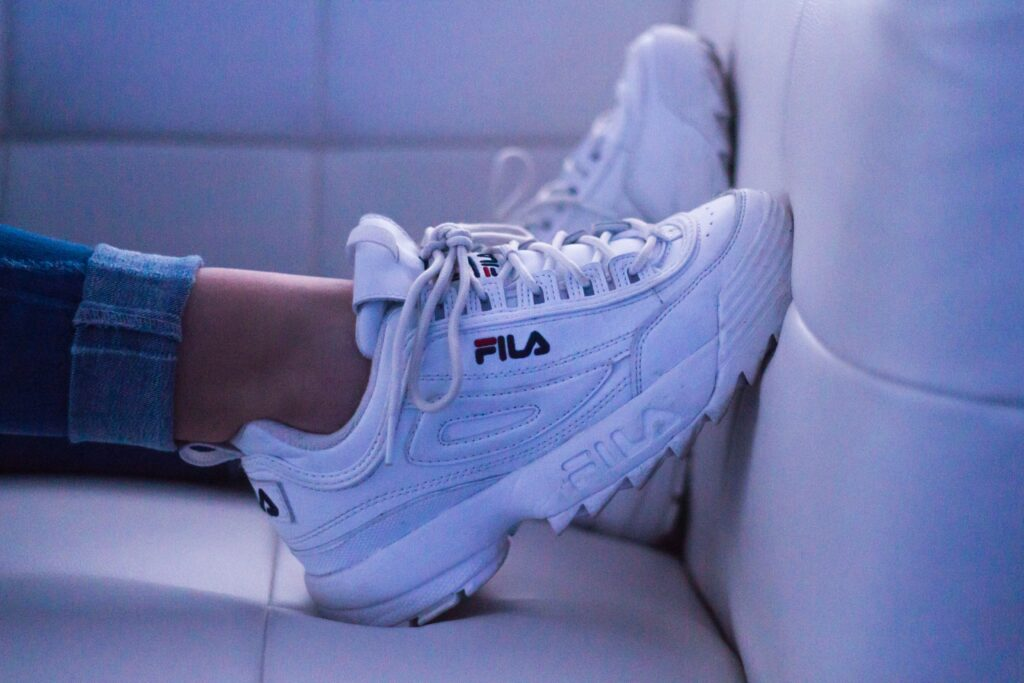 Woman wearing Fila sneakers.