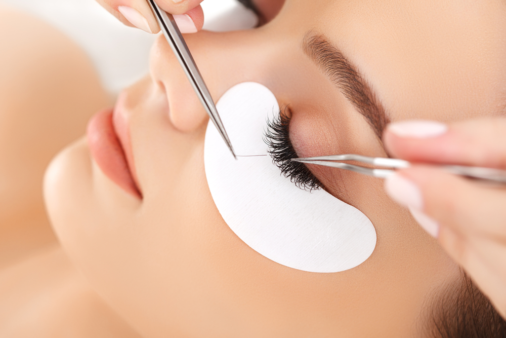 Woman getting eyelash extensions.