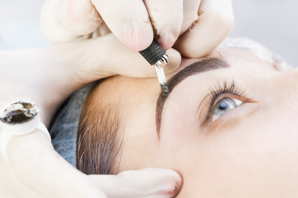 Woman receiving a microblading treatment.