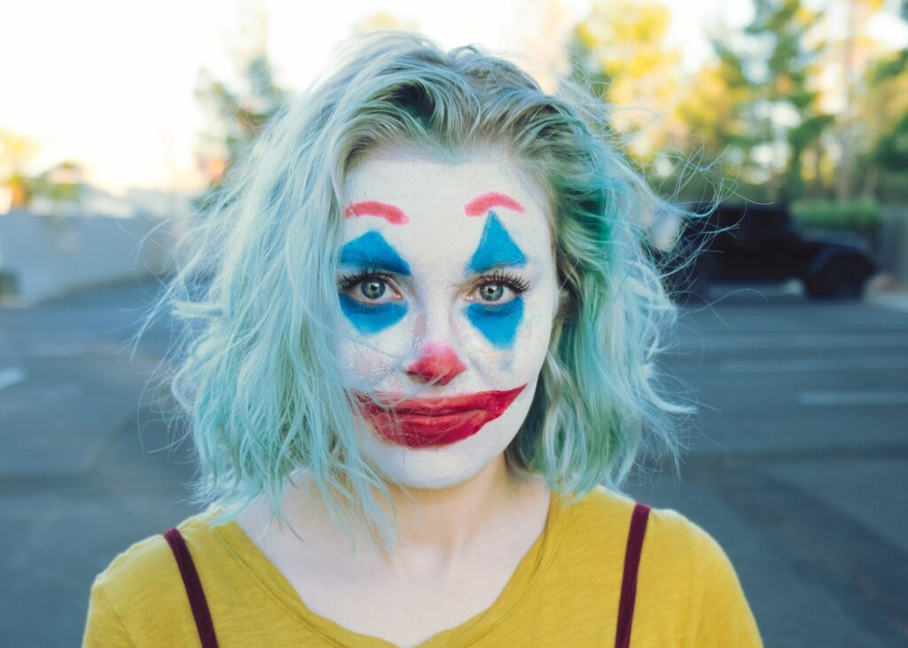 Woman wearing clown makeup
